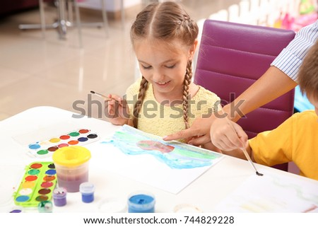 Shutterstock Little girl at painting lesson in classroom