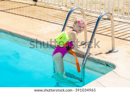 little girl at swimming pool #391034965