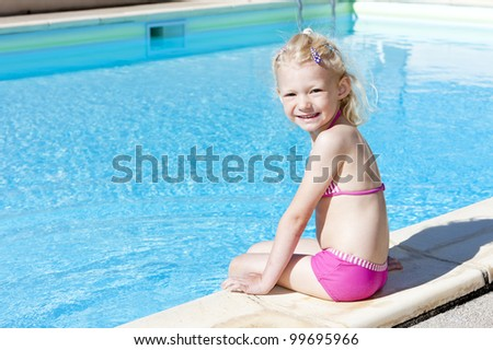 little girl at swimming pool - stock photo