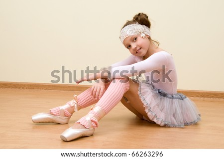 Little girl at the ballet class