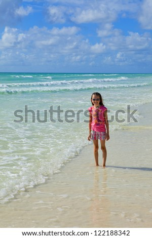 little girl at the beach in the bahamas