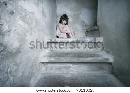 little girl bare feet on the basement stairs