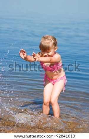 little girl bathed in the sea