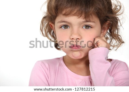 Little girl blowing her cheeks
