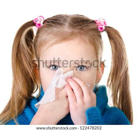 Little girl blowing her nose closeup isolated on white