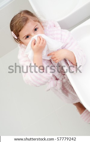 Little girl blowing nose