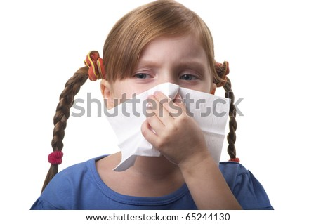 Little girl blowing nose in tissue isolated over white background