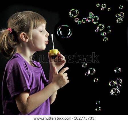 Girl Blowing Soap Bubbles Little Girl Blowing Soap
