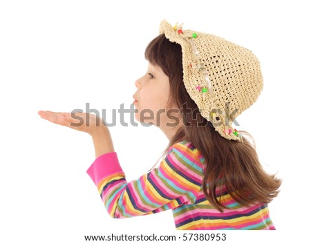 Little girl blows with an empty hand, isolated on white