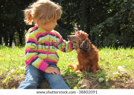http://image.shutterstock.com/display_pic_with_logo/4225/4225,1255437489,42/stock-photo-little-girl-caress-dachshund-outdoor-38802091.jpg