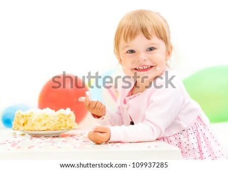 Little girl celebrating here second birthday