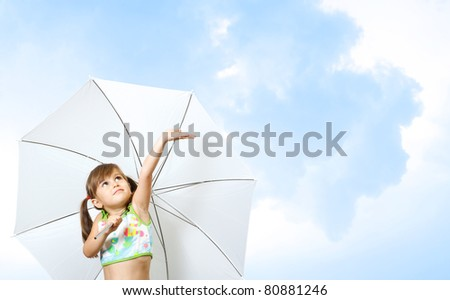 little girl child with umbrella on sky background