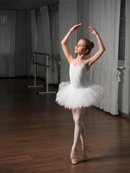 Little girl classic ballet dancer in studio