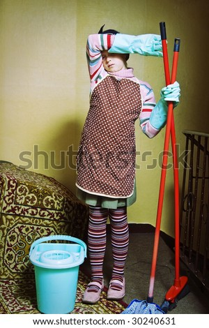 Little girl cleaning an old dirty house