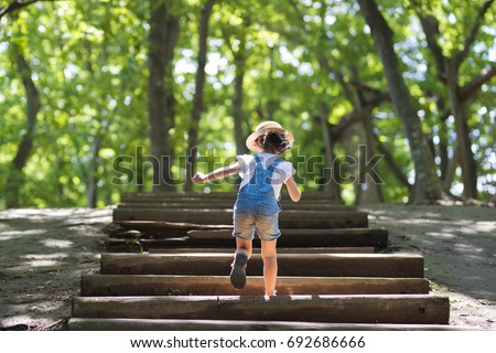 Shutterstock Little girl climbing the stairs in the forest