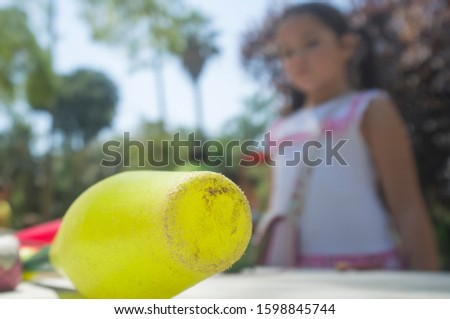 Little girl close to lub, juggling clubs in the park. Classic games for children concept Zdjęcia stock ©