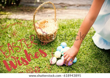 Little girl collecting easter eggs against happy easter red logo against a white background #618943895