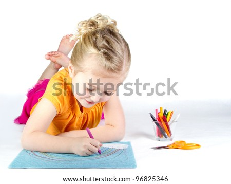Little girl coloring a rainbow on white background