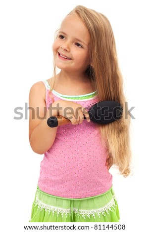 Little girl combing her long beautiful hair