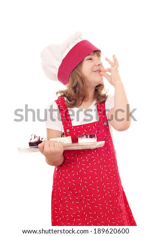 little girl cook with sweet cakes and ok hand sign