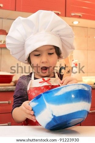 Little girl cooking in the kitchen