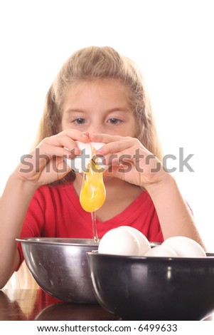 little girl cracking an egg over bowl