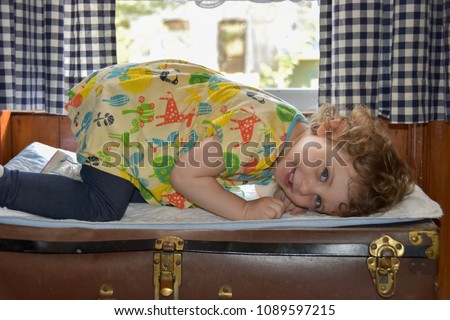 little girl crouching sideways...