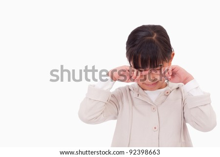 Little girl crying against a white background