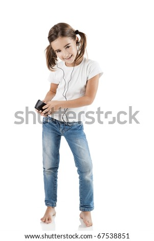 Little girl dancing while listen music with a MP3 player, isolated on white