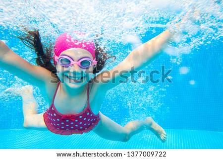 little girl deftly swim underwater in pool Photo stock ©