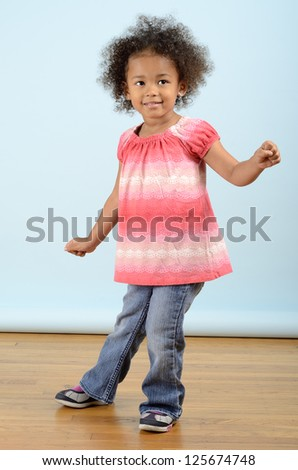 Little girl doing a dance