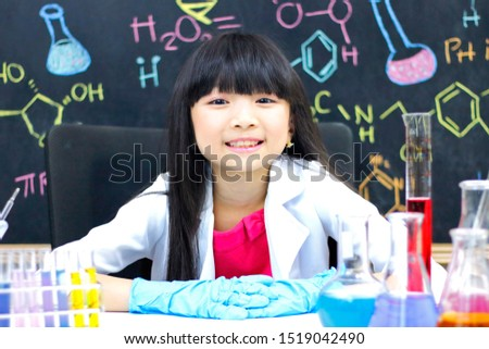 Little girl doing experiments in the laboratory. Science and education.