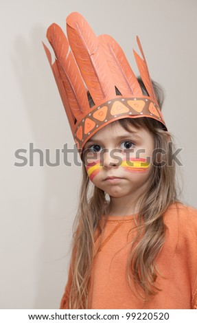 Little girl dressed as Indian with the painted face