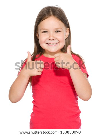 Little girl dressed in red is showing thumb up gesture using both hands, isolated over white