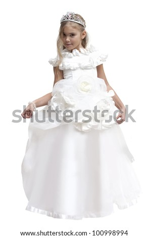 Little girl dressed up as a white fairy with crown