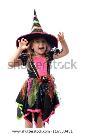 Little girl dressed up as a witch isolated on white