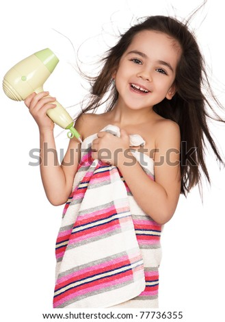 Little girl dries hair after bathing isolated on white background