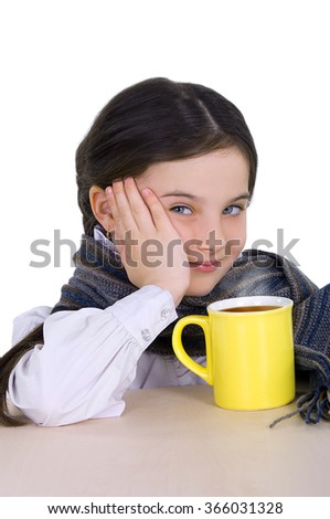 little girl drinking from a cup of hot drink tea in cold weather. on a white background #366031328