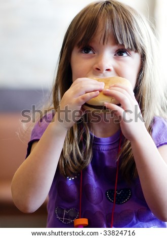 fat person eating burger. girl eating a urger