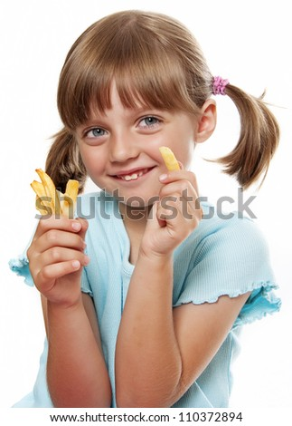 little girl eating a french fries isolated on white background