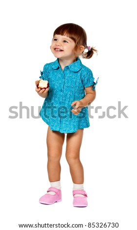 little girl eating an apple on a white background