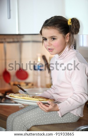 little girl eating at the kitchen