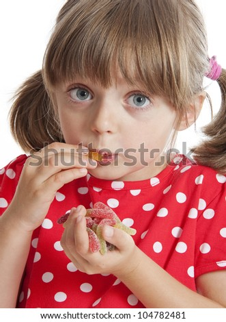 little girl eating gelatin candy