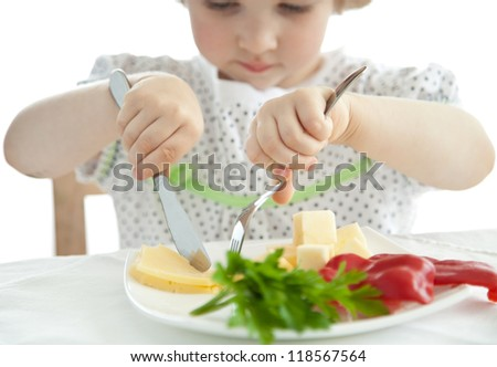 Little girl eating her dinner; isolated on white