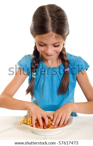 little girl eating spaghetti with hand - stock photo