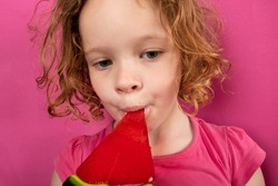 little girl eating watermelon candy, children love sweets.