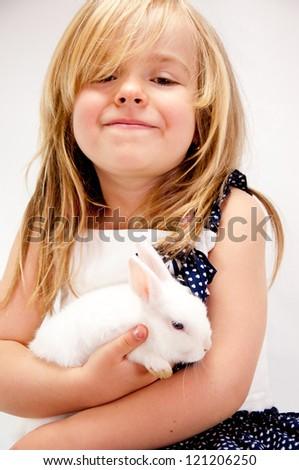 Little Girl Embracing Her Pet Rabbit