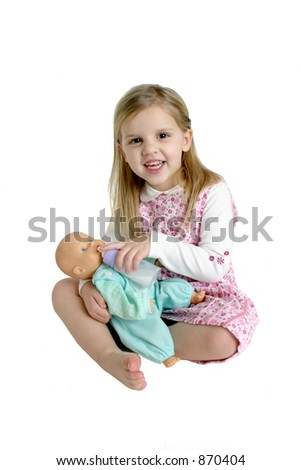 Little Girl Feeding a Baby Doll