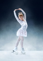 Little girl figure skating at the indoor ice arena. The dance, sport, winter, exercise, training, childhood, champion concept