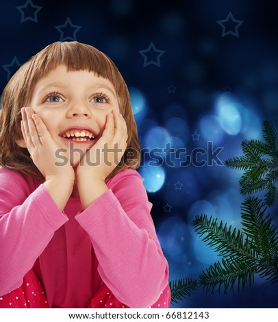 little girl four years old and christmas tree